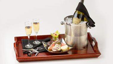 room service tray with desserts and champagne